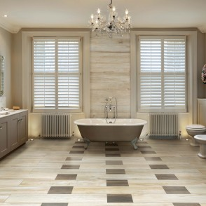 Imposing family home on the edge of Clapham Common, London. Originally designed by James Knowles in 1863. Large master ensuite bathroom with accent lighting double sink unit and roll-top bath